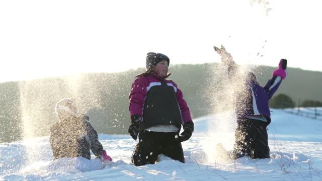 three girls playing with snow slow motion - endast flickor bildbanksvideor och videomaterial från bakom kulisserna