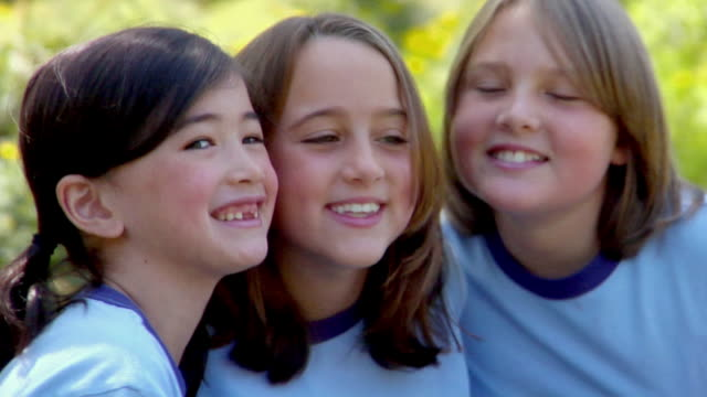 cu, three girls (8-11) posing cheek to cheek outdoors, bovina, new york state, usa - cheek to cheek stock videos & royalty-free footage