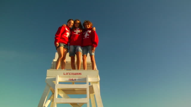 ms, la, three girls (10-11, 12-13) posing on lifeguard chair, portrait, provincetown, massachusetts, usa - lifeguard chair stock videos & royalty-free footage