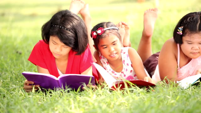 three girls reading book - petite teen girl stock videos and b-roll footage