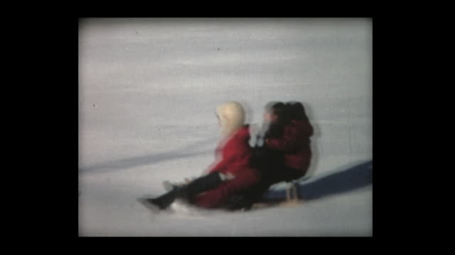 1968 three girls riding and pulling a toboggan - sledge stock videos & royalty-free footage