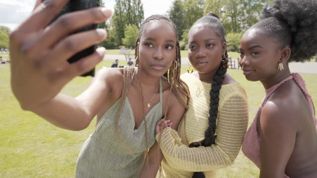three girls together making a selfie - matching outfits stock videos & royalty-free footage