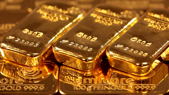 ms three gold ingots  on other gold / hanau, hesse, germany                       - ingot stock videos & royalty-free footage
