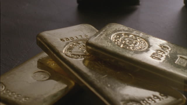 cu, pan, three gold ingots - ingot stock videos and b-roll footage