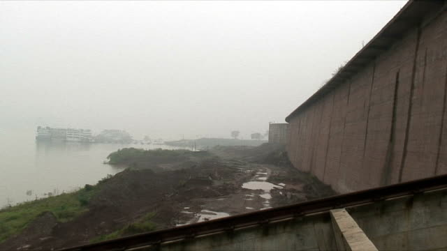 WS Three Gorges Dam in fog, Upriver of 3 Gorges Dam, China