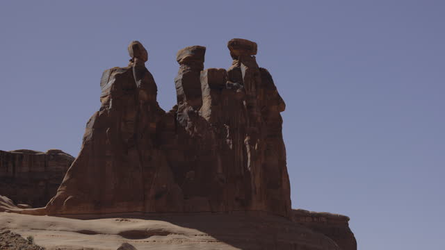 three gossips rock formation at arches national park / moab, utah, united states - moab utah stock videos & royalty-free footage