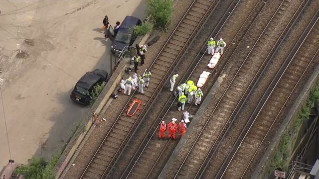 three graffiti artists killed by passing train; england: london: loughborough junction: ext air views / aerials police officer on track by three dead... - railway junction stock videos & royalty-free footage