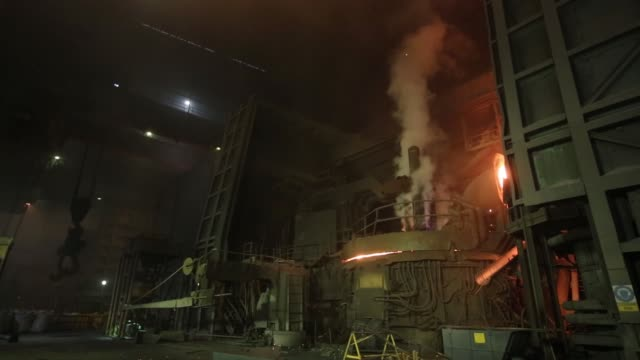 Three graphite electrodes glow red hot in an electric arc furnace at the electric steelmaking shop at the Volzhsky Pipe Plant OJSC operated by TMK...
