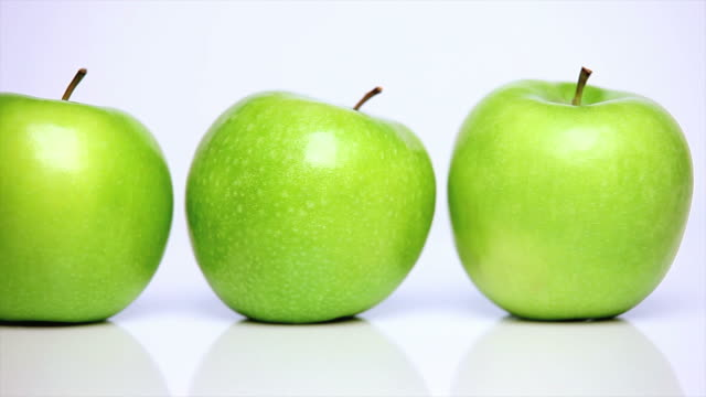 hd three green apples dolly shot - frische stock videos & royalty-free footage
