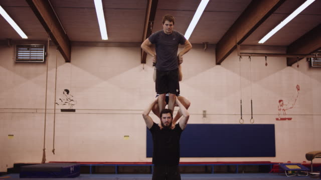 three gymnasts making a tower - trust stock videos & royalty-free footage