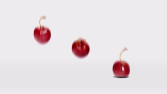 vídeos de stock e filmes b-roll de three happy jumping cherries in a row animation - number 3