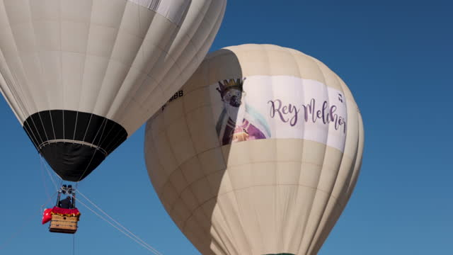 three hot air ballons, one for each of the three wise men , fly over the ground where children and parents wait to greet them on january 5 in las... - number 3 stock videos & royalty-free footage