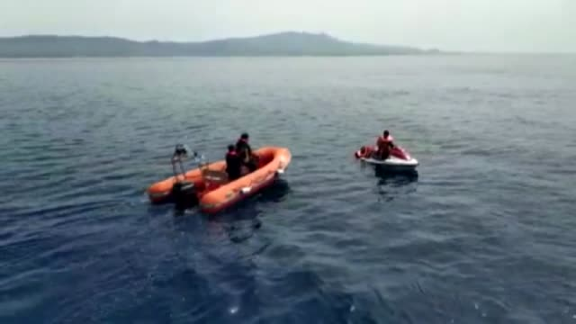 vídeos de stock, filmes e b-roll de three illegal migrants were held while attempting to cross greece's lesbos island with jet ski from turkey's south western coastal province mugla on... - província de mugla
