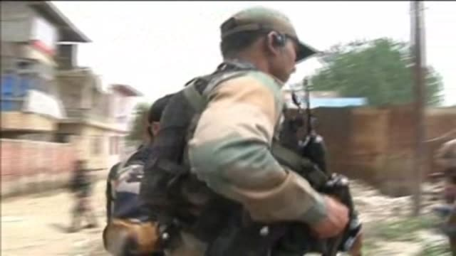 three indian policemen were shot dead at point-blank range on monday in srinagar of indian occupied kashmir in the first such attacks in almost three... - rebellion stock videos & royalty-free footage