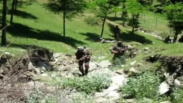 three islamic rebels were killed in an ongoing encounter at naugam sector of handwara in north kashmir's kupwara district of indian administered... - rebellion stock videos & royalty-free footage