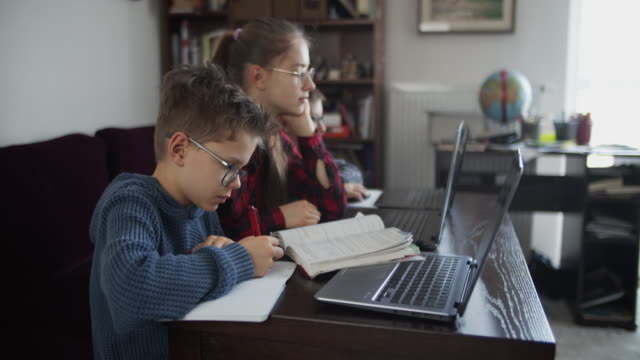 three kids attending to online school class. - e learning stock videos & royalty-free footage