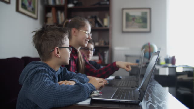 three kids attending to online school class. - real people stock videos & royalty-free footage