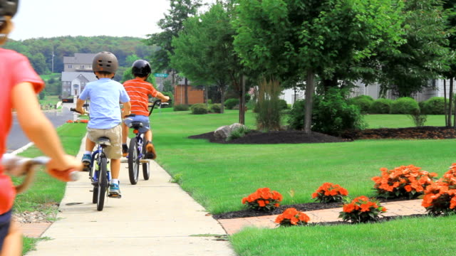 three kids biking away - small town stock videos & royalty-free footage