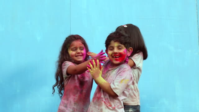 three kids celebrating holi festival - body paint stock videos & royalty-free footage