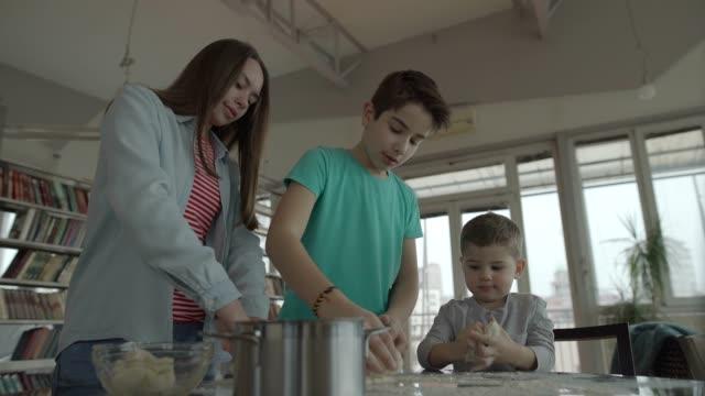 Three kids cooking