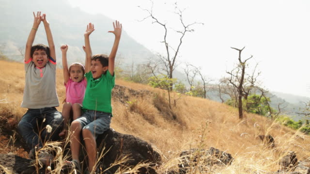Three kids enjoying at hill station