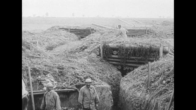 vs three large guns in the field shoot and recoil a trench with a few men and smoke from a gun in the foreground / a gunnery team takes aim from... - trench stock videos & royalty-free footage