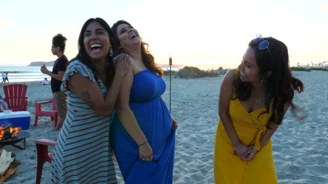 ms three laughing sisters on beach during family party at sunset - grace stock videos & royalty-free footage