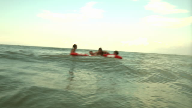 ws three lifeguards rescuing man / jacksonville, florida, usa - bagnino video stock e b–roll