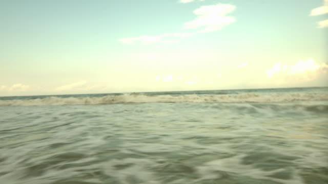 stockvideo's en b-roll-footage met ws pan three lifeguards running towards sea / jacksonville, florida, usa - badmeester