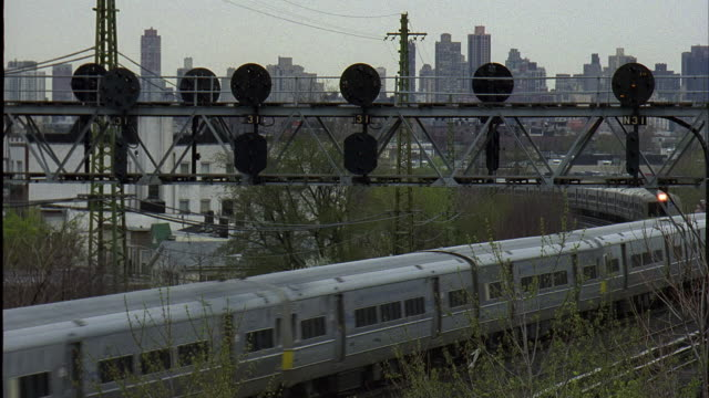 ha ws three long island rail road trains passing on tracks / new york city, new york, usa - long island railroad stock videos & royalty-free footage