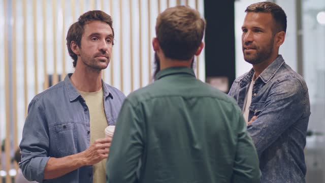 three male coworkers standing in the lobby, chatting during coffee break - lobby stock videos & royalty-free footage