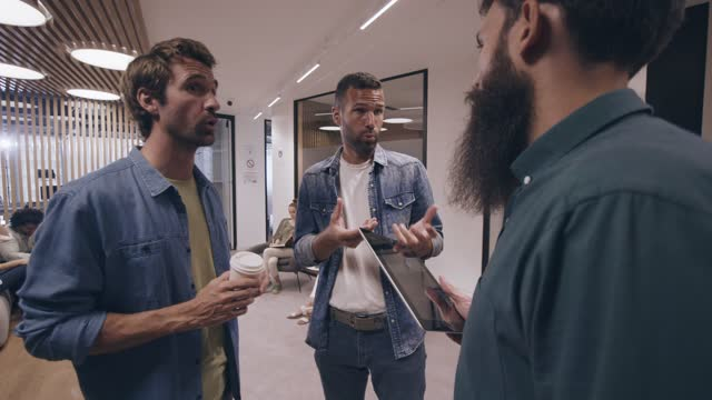 three male entrepreneurs talking about projects they are working on and exchanging business ideas - lobby stock videos & royalty-free footage