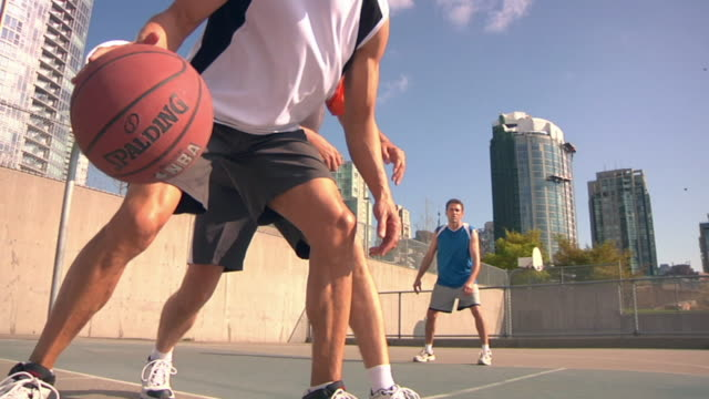 slo mo ms la three mature men playing basketball, vancouver, british columbia, canada - 55 59 jahre stock-videos und b-roll-filmmaterial
