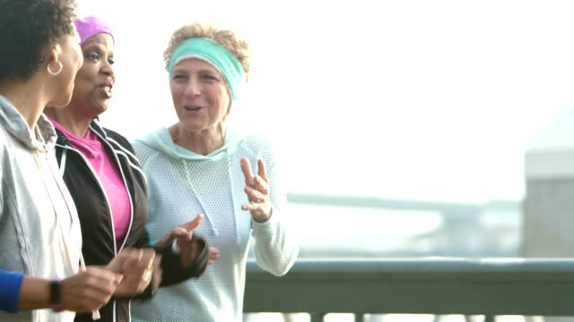 three mature multi-ethnic women exercising in city - racewalking stock videos and b-roll footage