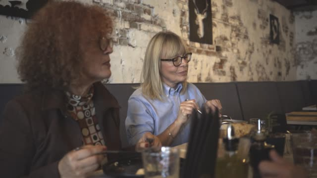 three mature women have a lunch - only mature women stock videos and b-roll footage