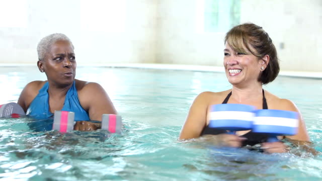 three mature women talking, doing water aerobics - exercise class stock videos & royalty-free footage
