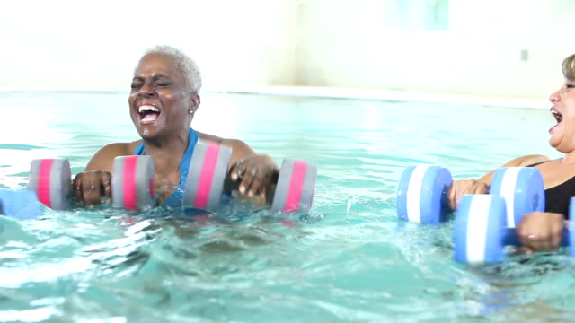 three mature women talking, doing water aerobics - relaxation exercise stock videos and b-roll footage
