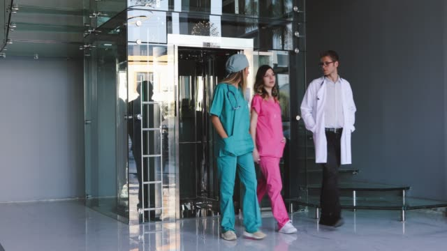 three medics walking along hospital corridor - leaving hospital stock videos & royalty-free footage