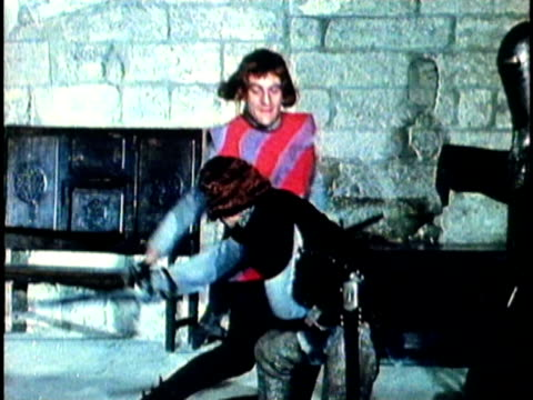 1956 reenactment montage three medieval knights practicing swordfighting inside castle  - rivalry stock videos & royalty-free footage