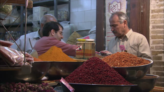 ms three men at specie stall on bazaar, isfahan, iran - iran stock videos & royalty-free footage