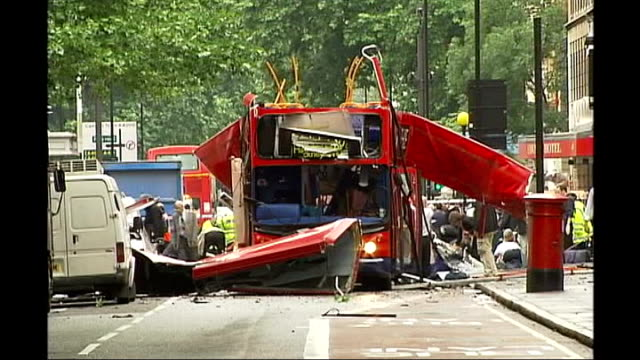 three men charged in connection with london 7/7 bomb attacks tx london ext aftermath of london 7/7 bomb blasts showing wreckage of bombed bus and... - anweisungen geben stock-videos und b-roll-filmmaterial