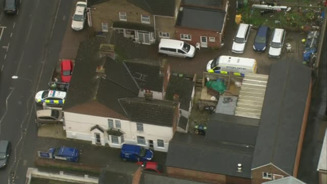 three men on trial for planning to carry out beheadings lib / high wycombe house linked to terrorism arrest with police car parked outside and police... - バッキンガムシャー点の映像素材/bロール