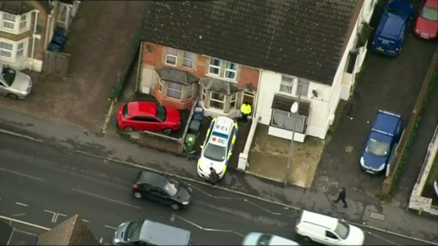 three men on trial for planning to carry out beheadings lib / 7112014 high wycombe police car and police officer outside property - バッキンガムシャー点の映像素材/bロール