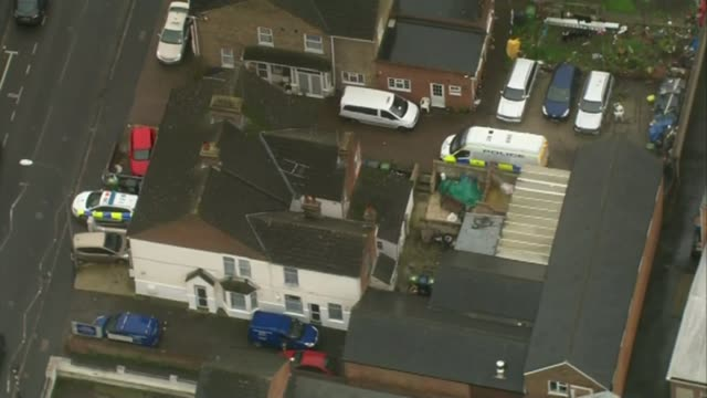 three men on trial for planning to carry out beheadings t07111429 / tx high wycombe police car and police officer outside property - バッキンガムシャー点の映像素材/bロール