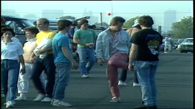 three men playing hacky sack in crowded parking lot in philadelphia pa - bean bag stock videos & royalty-free footage
