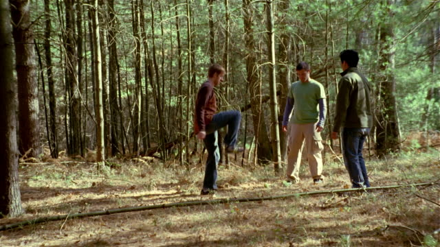 three men playing hacky sack in the woods - bean bag stock videos & royalty-free footage