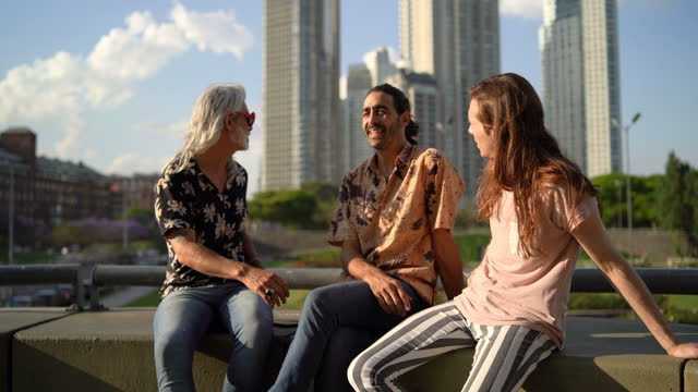 three men sitting outside and talking - puerto madero stock videos & royalty-free footage