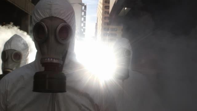 SLO MO CU REAR POV Three men wearing HAZMAT suits and gas masks, Atlanta, Georgia, USA
