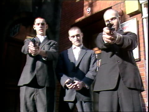 Three Men with Cap Guns Posing for Camera in London Alley