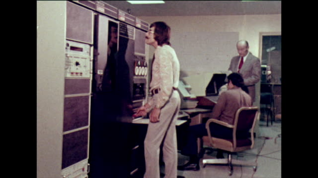 three men work in a cable tv control room; 1973 - old stock videos & royalty-free footage